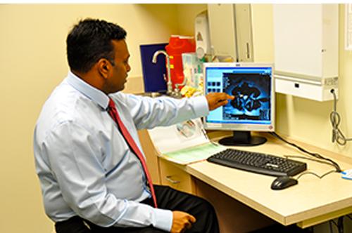 Dr. Chunduri Reading an X-Ray